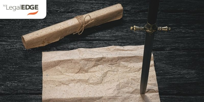 Contractual discretion represented by double edged sword sticking in paper contract on wood table